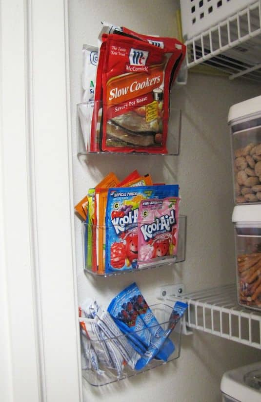 pantry organization idea for small items and food packets. -- Easy DIY small kitchen organization ideas and storage tips for your cabinets, your countertops, under your sink and in your pantry! I'll bet you could go to the dollar store or dollar tree and do these projects for cheap. These hacks are great for apartments! Listotic.com