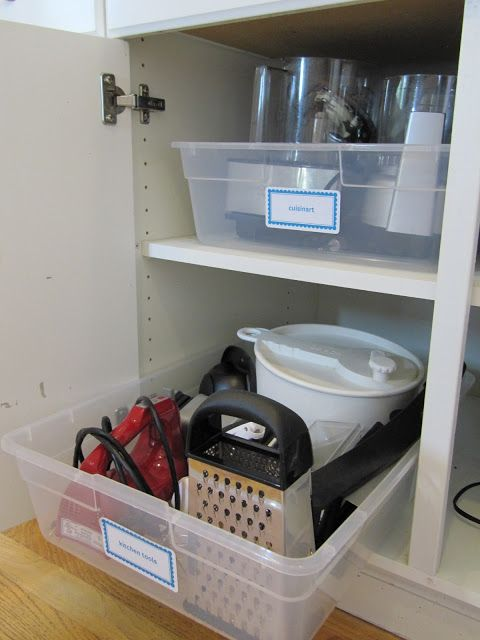 Pretend kitchen cabinet pull-outs using large plastic storage tubs. -- Easy DIY small kitchen organization ideas and storage tips for your cabinets, your countertops, under your sink and in your pantry! I'll bet you could go to the dollar store or dollar tree and do these projects for cheap. These hacks are great for apartments! Listotic.com