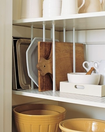 Use tension rods as dividers for upright storage. -- Easy DIY small kitchen organization ideas and storage tips for your cabinets, your countertops, under your sink and in your pantry! I'll bet you could go to the dollar store or dollar tree and do these projects for cheap. These hacks are great for apartments! Listotic.com