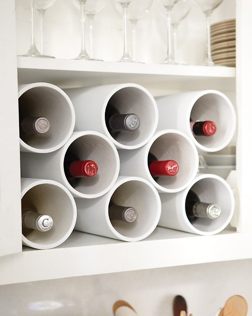 How to organize wine bottle for cheap. -- Easy DIY small kitchen organization ideas and storage tips for your cabinets, your countertops, under your sink and in your pantry! I'll bet you could go to the dollar store or dollar tree and do these projects for cheap. These hacks are great for apartments! Listotic.com