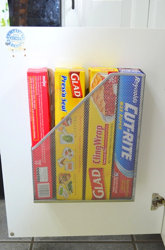 The best way to store kitchen wrap for small spaces. -- Easy DIY small kitchen organization ideas and storage tips for your cabinets, your countertops, under your sink and in your pantry! I'll bet you could go to the dollar store or dollar tree and do these projects for cheap. These hacks are great for apartments! Listotic.com