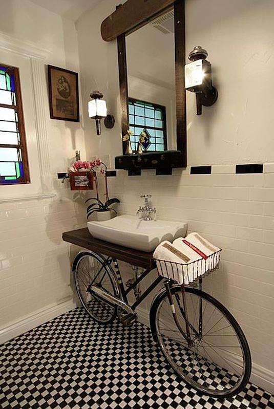 Bicycle Sink -- Easy DIY furniture makeovers and ideas! A lot of repurposed thrift store projects and chalk paint ideas so that you can do it for cheap. Before and after photos of dressers, tables, shelves, tv stands and more! For bedrooms and living rooms. Listotic.com