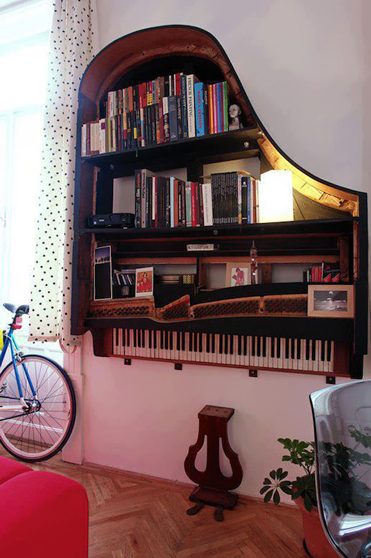 Old grand piano turned into a beautiful book shelf. -- Easy DIY furniture makeovers and ideas! A lot of repurposed thrift store projects and chalk paint ideas so that you can do it for cheap. Before and after photos of dressers, tables, shelves, tv stands and more! For bedrooms and living rooms. Listotic.com