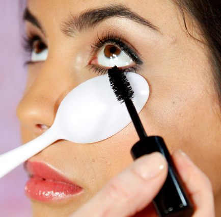 Use a plastic spoon to easily apply mascara on your bottom lashes without getting any on the skin under your eyes. It also helps you to accomplish a much thicker coat.