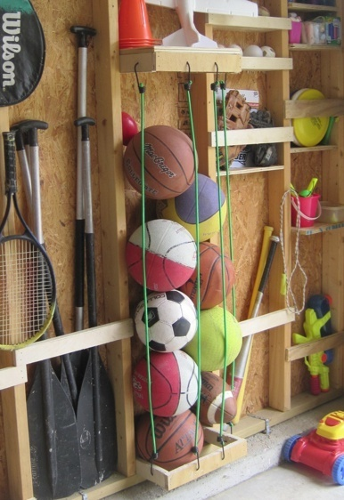 How to organize sports equipment and balls in the garage. -- Easy DIY garage organization ideas and storage tips! A ton of cheap inspiration to get you organized. Everything from shelves to tools! Men AND women will love these tips and tricks. Listotic.com