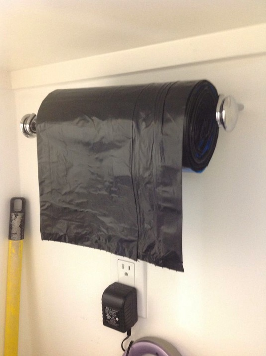Use A Paper Towel Holder For Garbage Bags.    Easy DIY Garage Organization  Ideas