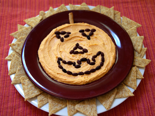 Jack-o-lantern hummus plate easy party recipes for a crowd.