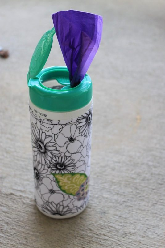 50 Genius Storage Ideas ~ Reuse disinfectant containers for doggy poo bags!