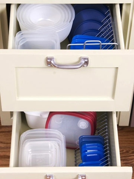 50 Genius Storage Ideas ~ Use a CD rack to store tupperware lids!