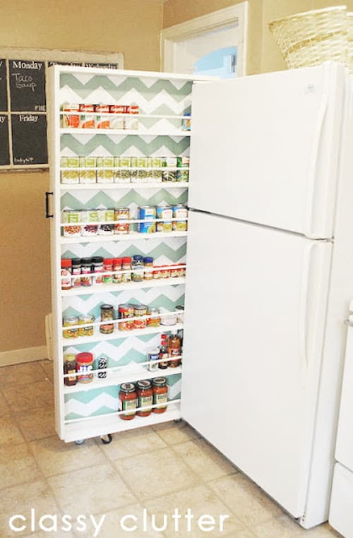 #18. Make a narrow slide-out cabinet for extra kitchen storage! | 29 Sneaky Tips For Small Space Living -- A ton of clever hacks and storage ideas for small spaces, homes and apartments! Small bedroom, bathroom, living room and kitchen ideas on a budget (DIY and cheap). Small space living isn't so bad! Even with kids. Listotic.com