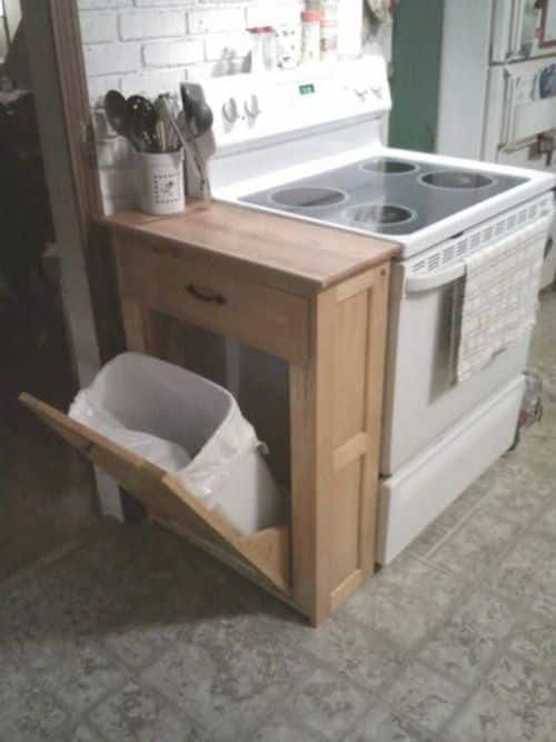 #27. Make a DIY garbage can cabinet and cutting board countertop for your small kitchen! | 29 Sneaky Tips For Small Space Living -- A ton of clever hacks and storage ideas for small spaces, homes and apartments! Small bedroom, bathroom, living room and kitchen ideas on a budget (DIY and cheap). Small space living isn't so bad! Even with kids. Listotic.com