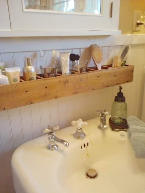make up and brush holder over a bathroom sink