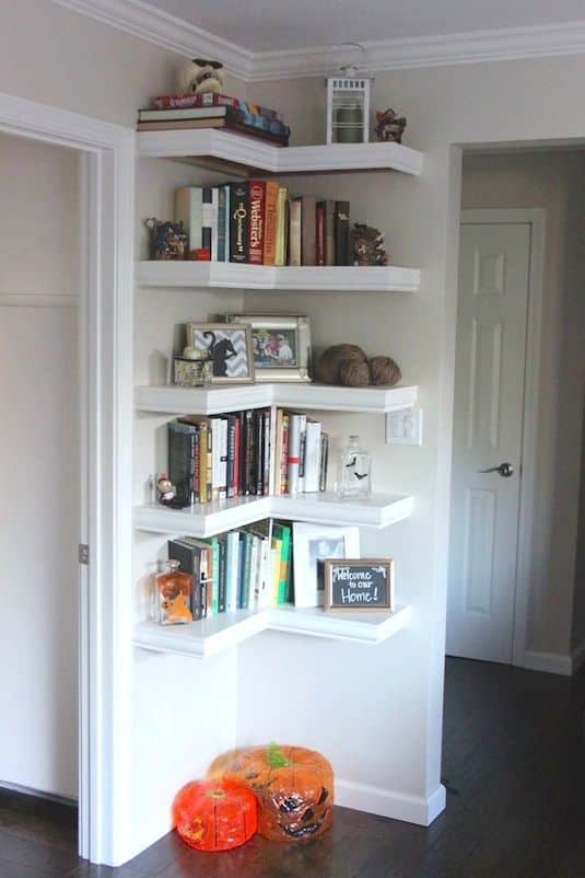 A diy storage ideas for smalls spaces like shelving in unused corners of the house. This small space hacks makes use of a corner wall between doorways with book shelves.