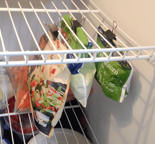#10. Use binder clips to keep your freezer bags closed and utilizing empty air space in your freezer. | 11 Brilliant Fridge and Freezer Organization Ideas -- Use these refrigerator tips and tricks to keep your fridge organized and clean! A few of these DIY hacks will also free up space and save you a few bucks on wasted or spoiled food (a few dollar store ideas here). | Listotic