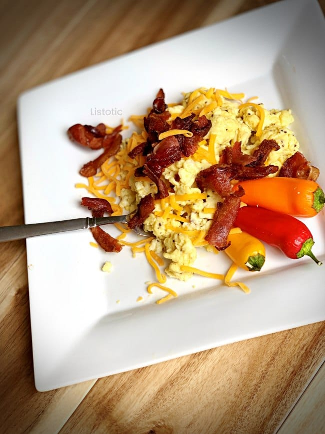 Keto friendly meal with scrambled eggs, bacon and cheese.