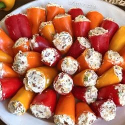 Cream Cheese filled jalepeno peppers (Party Poppers) on a plate.
