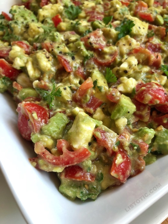 This quick and easy party appetizer is the BEST make ahead dip you will ever make! Serve it up with chips for a simple finger food everyone will love. It's made with avocados, tomatoes, feta and parsley.