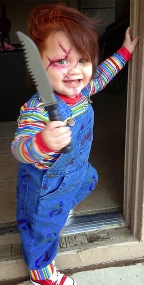 Creepy and scary costume idea for a baby or toddler! Homemade Chucky Costume. Blue bib overalls, striped shirt carrying a plastic knife.