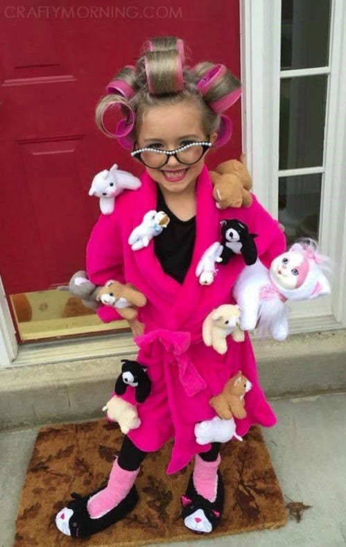 Funny Cat Lady Halloween Costume-- hilarious! Little girl with rollers in her hair, old lady glasses, pink robe and cats attached to the robe. Plus, cat slippers!
