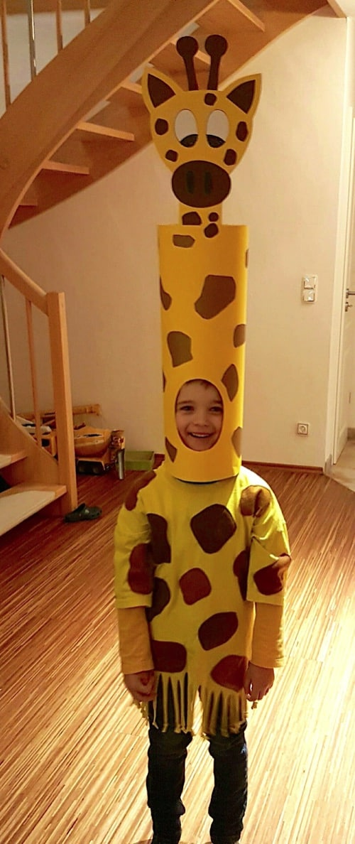Homemade Giraffe Costume-- super funny! Boy in spotted cape with tall spotted hat and giraffe face attached to the top of the hat.