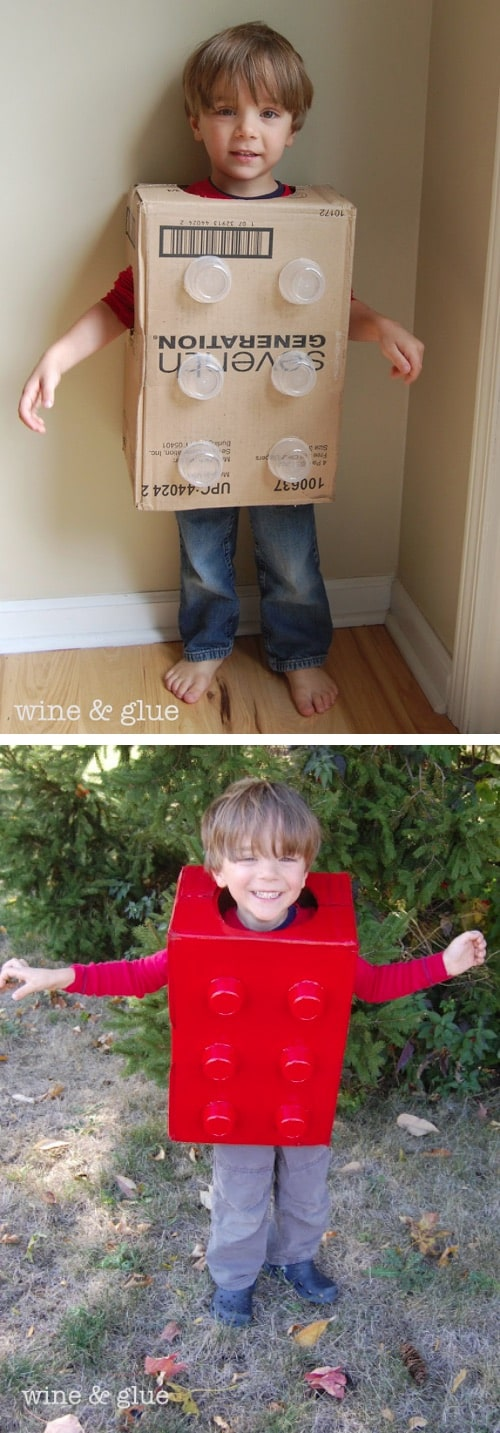 Boy in a box with applesauce cups attached and spray painted to look like a lego block Halloween costume.