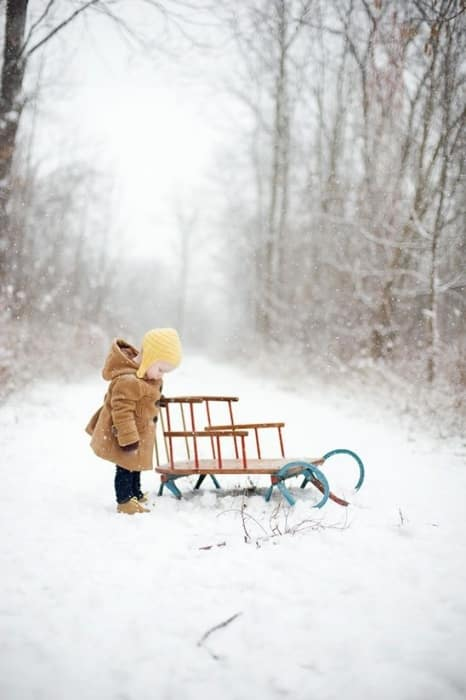 Perfect Christmas photo. Capture first time events, like this first sledding ride for a toddler.