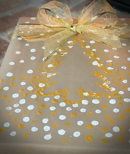 Handmade gold and white Christmas tree wrapping.