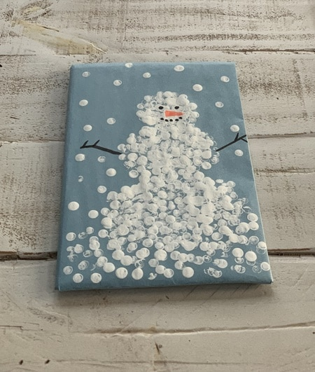 Painted snowman wrapping paper.