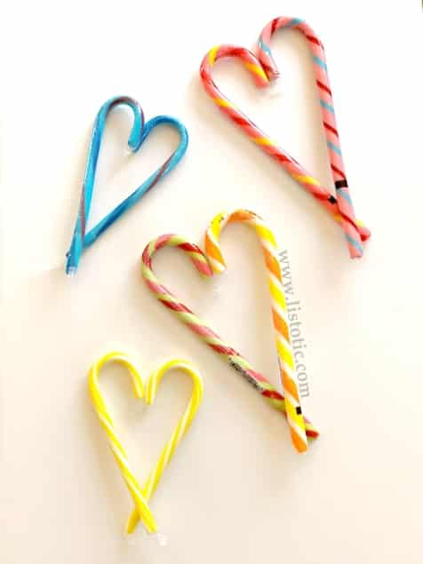 Budget friendly Ideas for kids to DIY candy cane Valentine hearts.