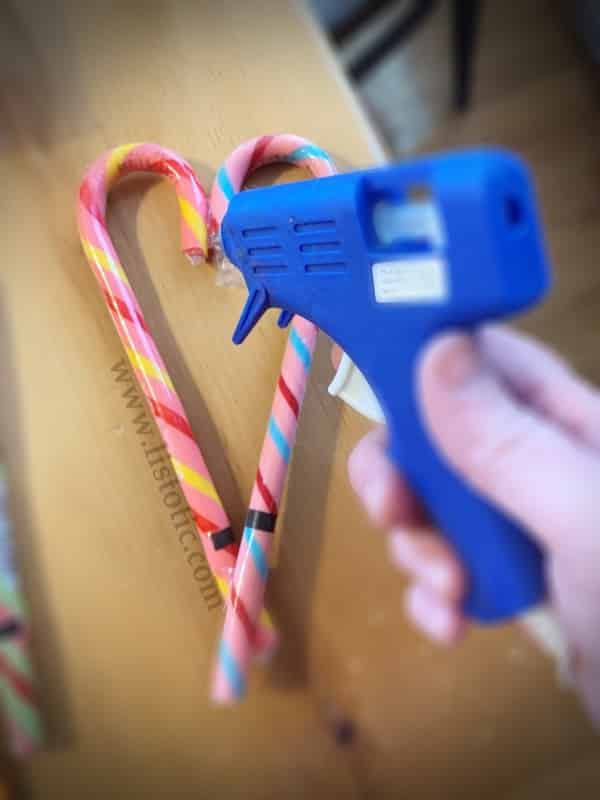 Easy idea for using Candy Canes and hot glue to diy a Happy Valentine's Day party favor.