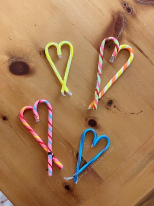 Low cost DIY Valentine's gifts.  Candy canes in the shape of hearts.