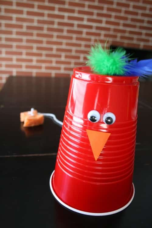 Easy and fun musical chicken craft made from a solo cup that clucks when you pull the string.