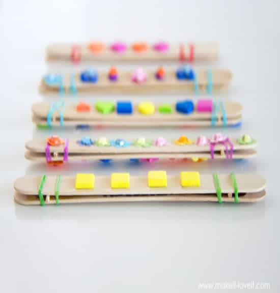 Simple DIY popsicle stick harmonica craft so easy your kids can make all of their own.