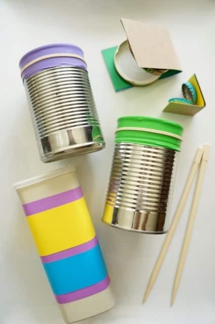 DIY recyclable shaker and castanets made from bottle caps and small food boxes.