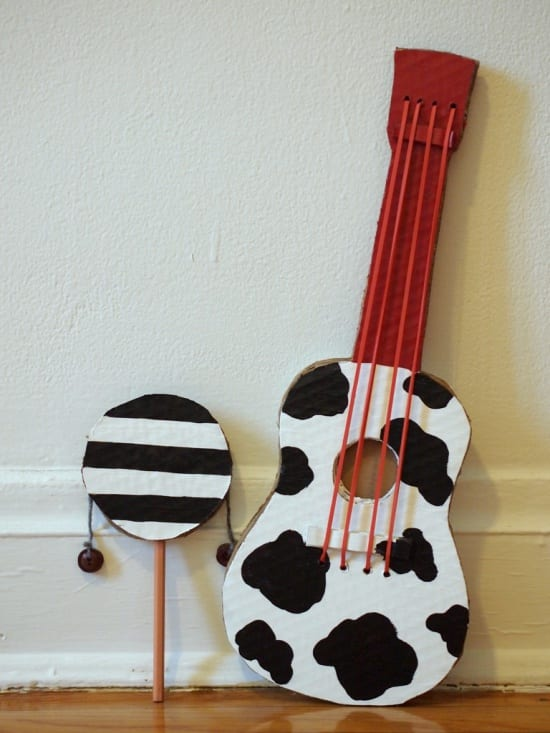 Easy to make DIY instruments for kids including cow print guitar and rattle drum.