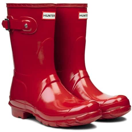 Women's red rain boot, perfect with an outfit for traveling or work. Hunter brand red rain boot found at Amazon.