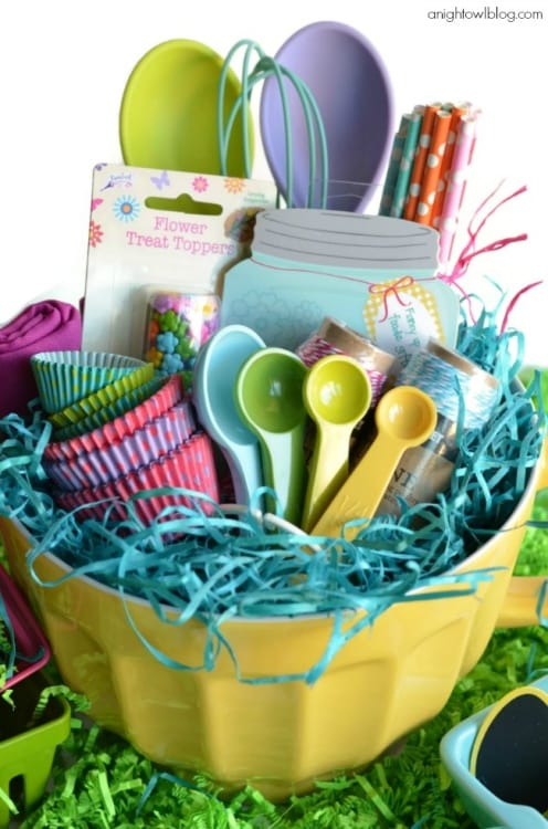 Baking lovers Easter Basket alternative filled with all of your baking essentials such as cupcake liners, measuring spoons, whisks, Easter Bunny sprinkles, notepad, colorful straws and more.