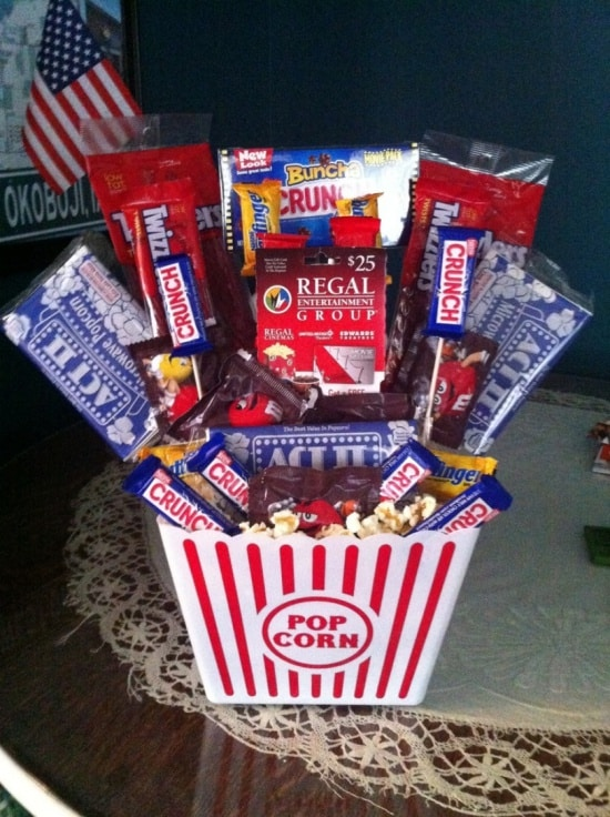A great Easter basket alternative is a popcorn bucket filled with your go to movie essentials and movie gift card.