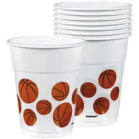 Stack of white plastic cups with printed basketball images for a March Madness Tournament basketball themed party.