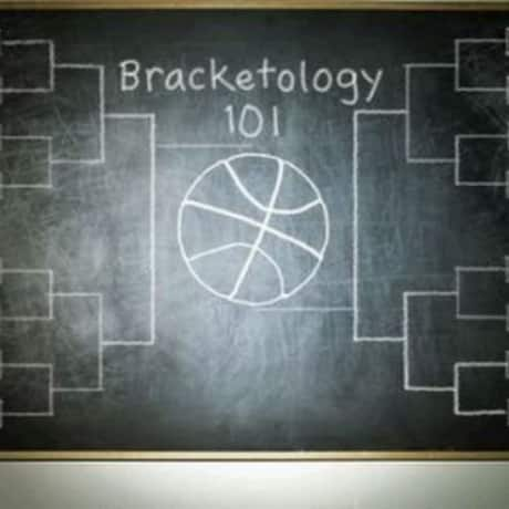 Chalkboard with hand written Bracketology 101 and NCAA College Basketball March madness tournament bracket prediction table.