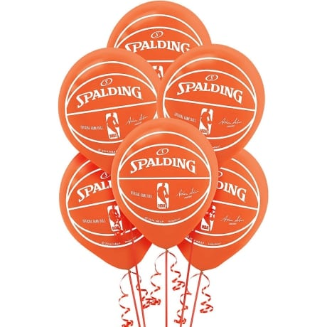 Grouping of 6 orange party city balloons with imprint of the Spalding college basketball logo to be displayed at a March madness party.