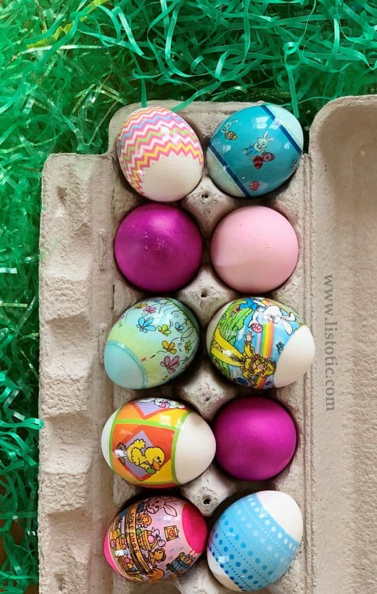 Variety of colorful hard boiled Easter Eggs in a egg carton for Easter decorating ideas