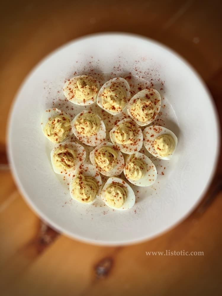 Easter deviled egg platter of classic deviled eggs sprinkled with paprika