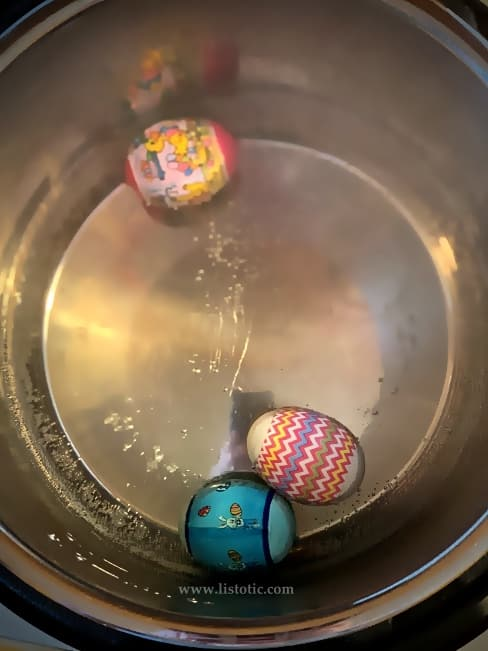 Simmering water in the Instant pot to quickly shrink wrap Easter Egg decorating kit sleeves