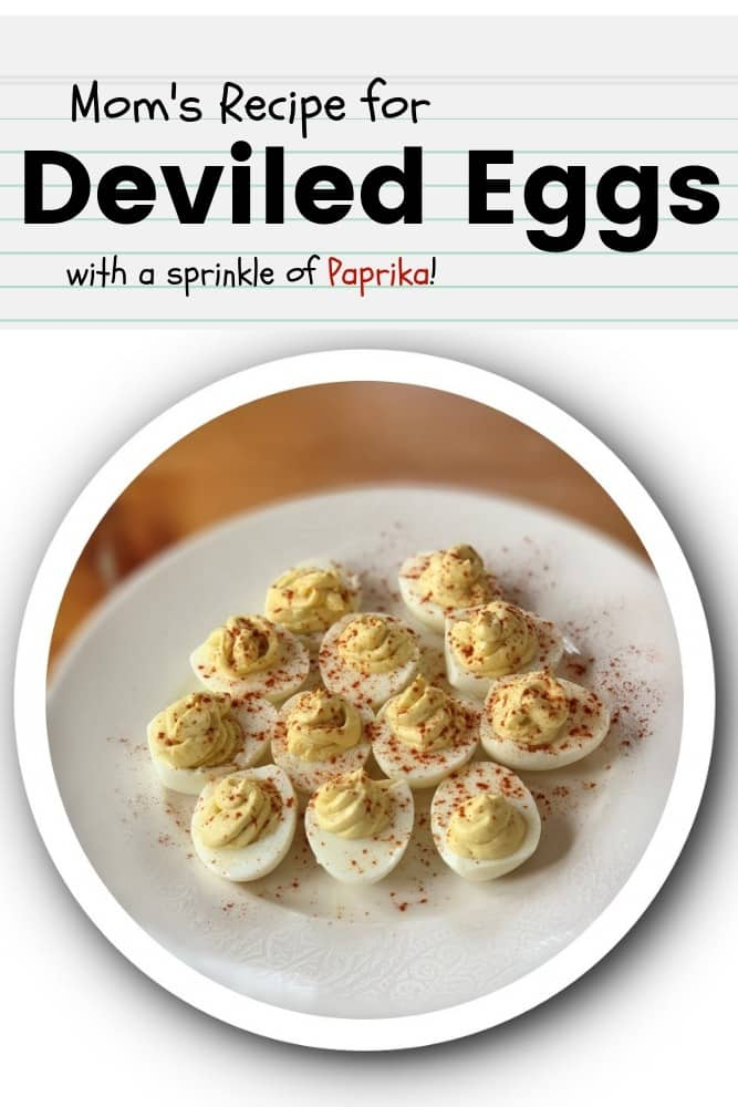White plate holding mom's deviled eggs sprinkled with paprika on a dining room table Pinterest Description: the best deviled egg recipe that that is easy classic and simple to make using mom's favorite deviled egg ingredients and a sprinkle of paprika for a fancy Easter deviled egg tray.