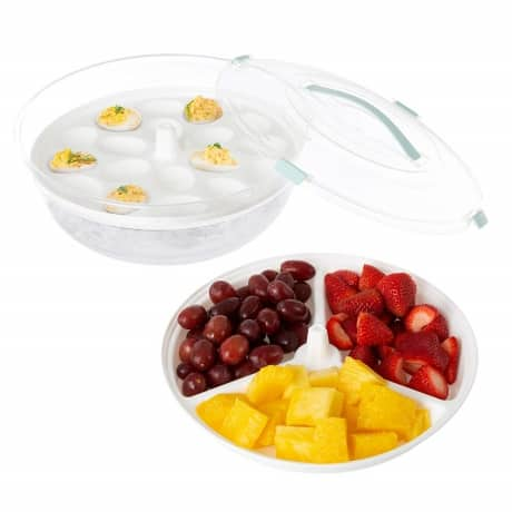 classic deviled eggs over ice in carrier specifically designed for deviled eggs and other fresh relish tray foods on a table for an appetizer at a party or event.