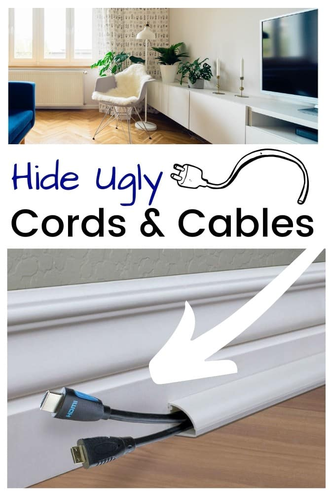 Baseboard channel to disguise and hide cords on floor leading to a mounted cable television behind TV stand in a living room.