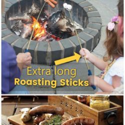 Parents helping a young girl roast marshmallows and hotdogs over an outdoor bonfire or campfire. Table with delicious looking fire roasted hot dogs and picnic sides.