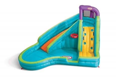 colorful little ties curved water slide with climbing wall and basketball hoop for kids to climb and slide down with water spraying on the slide.