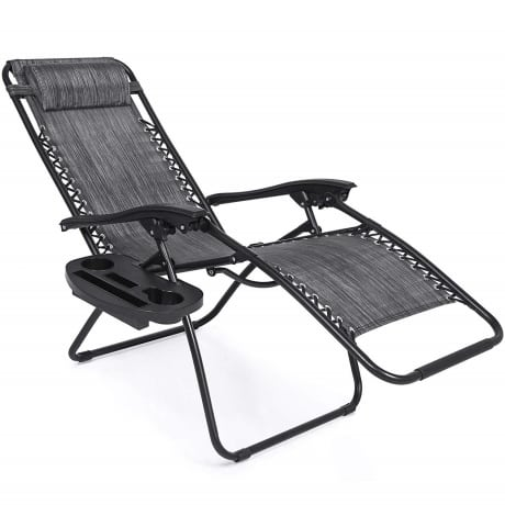 Reclining outdoor lounge chair in black fabric with cup holder, tray and head pillow.